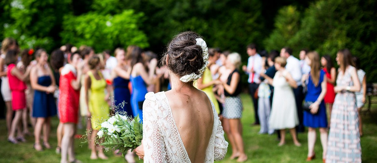 A Bride preparing to throw a bouquet of flowers